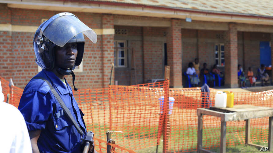 FILE - A police officer stand guards at a newly established Ebola response center in Beni, Democratic Republic of Congo, Aug. 10, 2018.