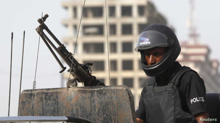 FILE - A policeman stands guard in Karachi, Pakistan, May 14, 2015.