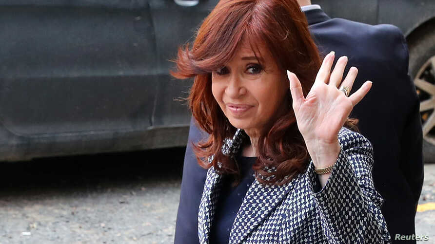Former Argentine President Cristina Fernandez de Kirchner waves as she leaves the Federal Justice building in Buenos Aires, Argentina, Sept. 18, 2018.