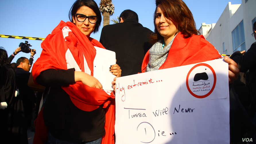 At a protest in Tunisia, activists are defiant, saying terrorism will not change their way of life, Tunis, March 19, 2015. (Mohamed Krit/VOA)