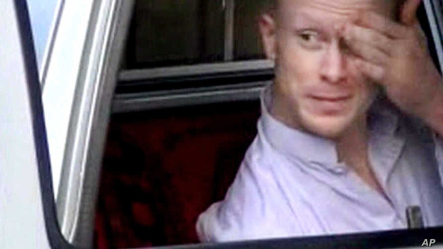 FILE - In this file image taken from video obtained from Voice Of Jihad Website, which has been authenticated based on its contents and other AP reporting, Sgt. Bowe Bergdahl, sits in a vehicle guarded by the Taliban in eastern Afghanistan.