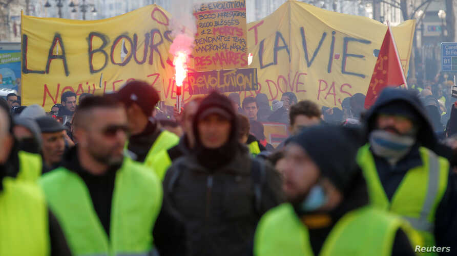 "FILE - Protesters wearing yellow vests take part in a demonstration of the ""yellow vests"" movement in Marseille, France, Jan. 26, 2019."