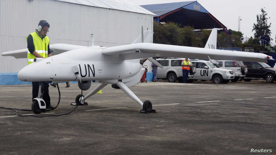 FILE - A technician checks a surveillance Unmanned Aerial Vehicles (UAV) drone operated by the United Nations in the Democratic Republic of Congo's eastern city of Goma.  United Nations forces in Democratic Republic of Congo launched unmanned aircraf