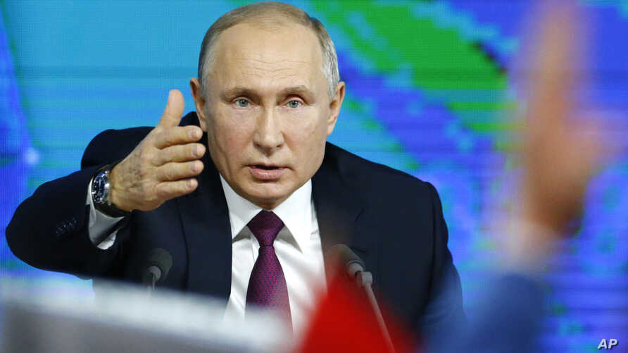 Russian President Vladimir gestures during his annual news conference in Moscow, Russia, Dec. 20, 2018.