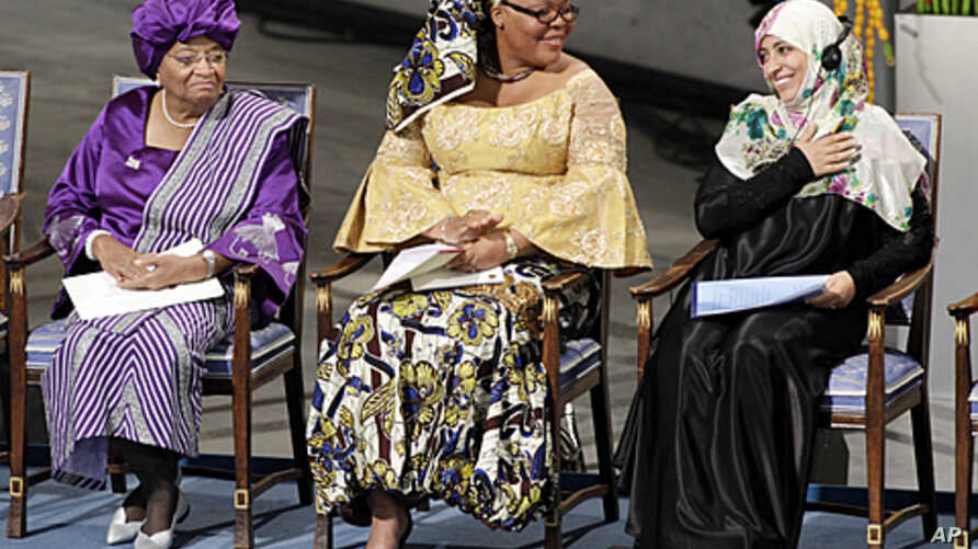 Nobel Peace Prize winners Liberian president Ellen Johnson-Sirleaf, left,  Liberian peace activist Leymah Gbowee, center, and Tawakkol Karman of Yemen, right, take the stage at City Hall in in Oslo, Norway, December 10, 2011.
