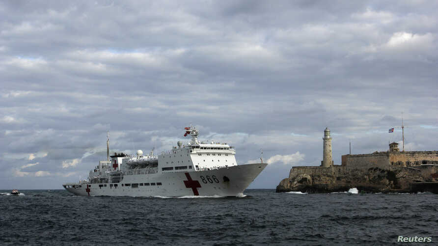 "FILE - Chinese navy hospital-ship ""Peace Ark"" passes by the lighthouse of the colonial fortress Morro Cabana as it enters Havana Harbor."