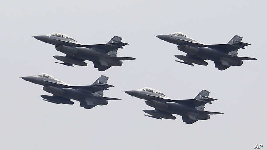 FILE - Pakistani Air Force F-16 fighter jets fly in formation during a military parade to mark Pakistan National Day, in Islamabad, Pakistan, March 23, 2019.