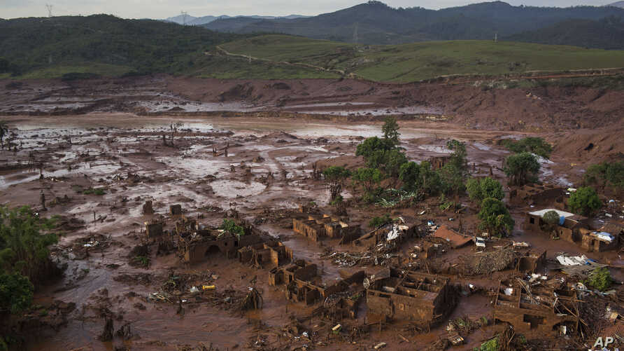 Aerial view of the debris after a dam burst at the small town of Bento Rodrigues in Minas Gerais state, Brazil, Nov. 6, 2015.