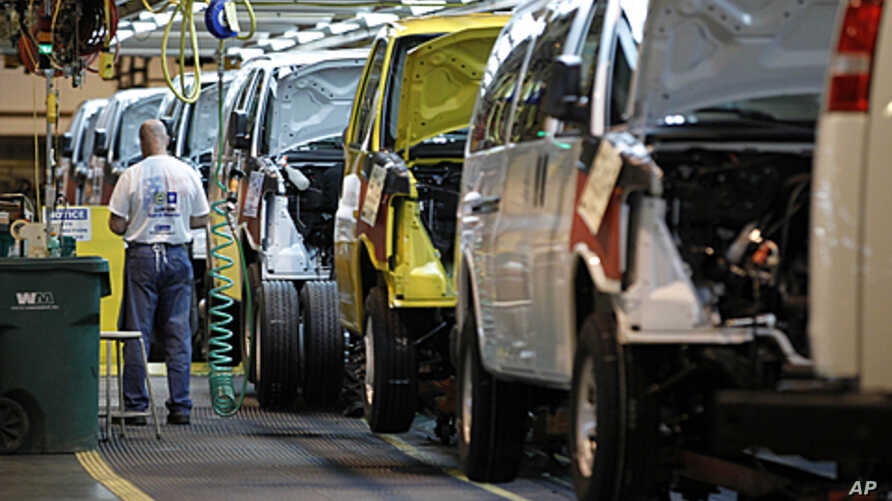 A General Motors employee works on a van assembly line at GM's plant in Wentzville, Missouri, November 3, 2011.