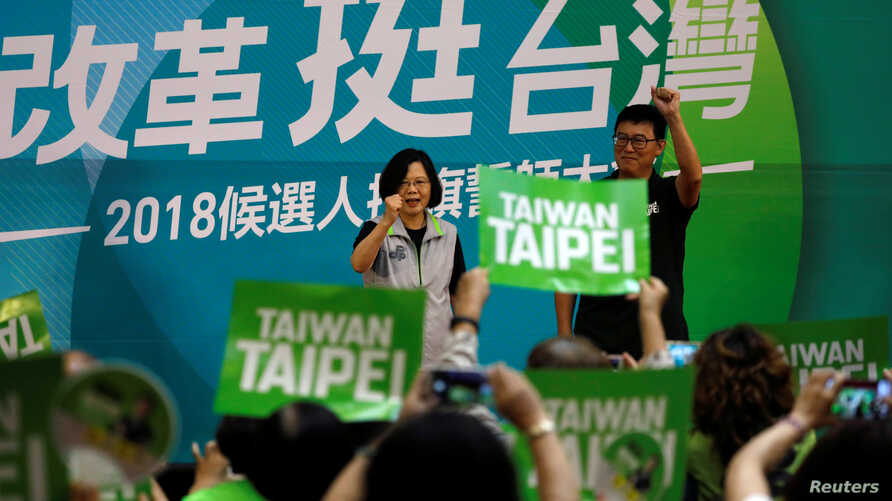 Taiwanese President Tsai Ing-wen and Democratic Progressive Party (DPP) Taipei mayoral candidate Pasuya Yao, attend a mayoral and magisterial election campaign rally in Taipei, Taiwan, Aug. 3, 2018.