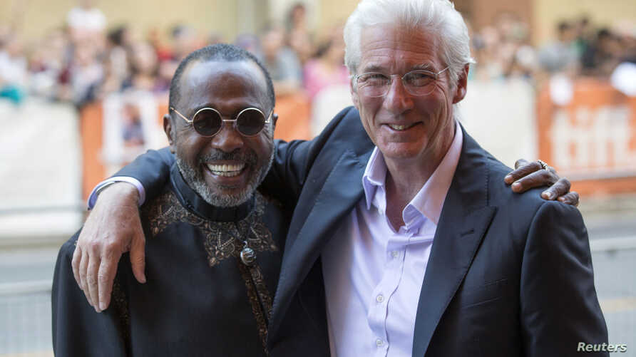 "Richard Gere hugs Ben Vereen (R) as they arrive for the ""Time Out of Mind"" gala at the Toronto International Film Festival (TIFF) in Toronto, Canada, Sept. 7, 2014."