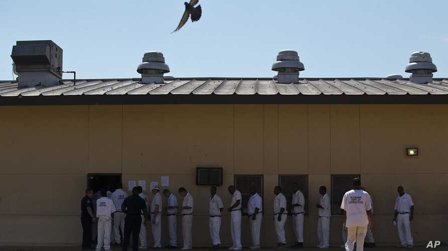 FILE - Prisoners stand in a crowded lunch line during a prison tour at Elmore Correctional Facility in Elmore, Alabama, June 18, 2015.
