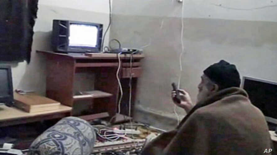 Osama bin Laden is shown watching himself on television in this video image released by the U.S. Pentagon, May 7, 2011
