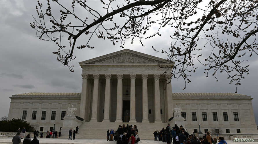 People wait in line outside the U.S. Supreme Court to hear the orders being issued, in Washington, U.S. March 18, 2019.