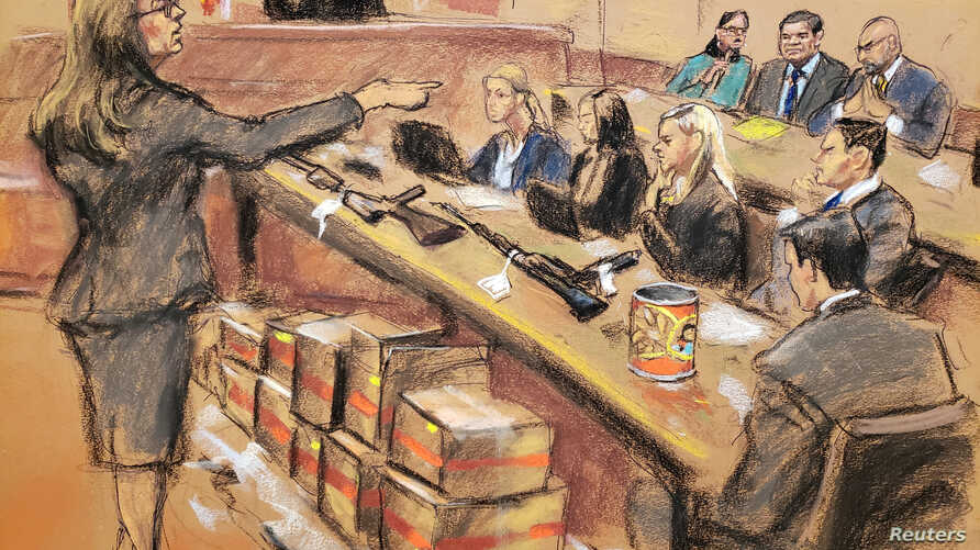 "Assistant U.S. Attorney Andrea Goldbarg points at Mexican drug lord Joaquin ""El Chapo"" Guzman, back row center, in this courtroom sketch during Guzman's trial in Brooklyn federal court in New York City,  Jan. 30, 2019."