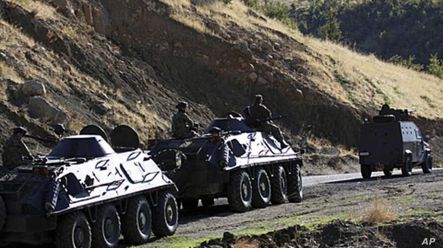 Turkish soldiers in armored vehicles patrol in Sirnak province on the Turkish-Iraqi border, October 21, 2011.