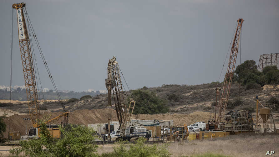 FILE - Heavy machinery is seen on the Israeli side of the border with Gaza Thursday, Sept. 8, 2016. Israel is building an underground barrier along the border with Gaza to block Hamas militants from tunneling into Israel.