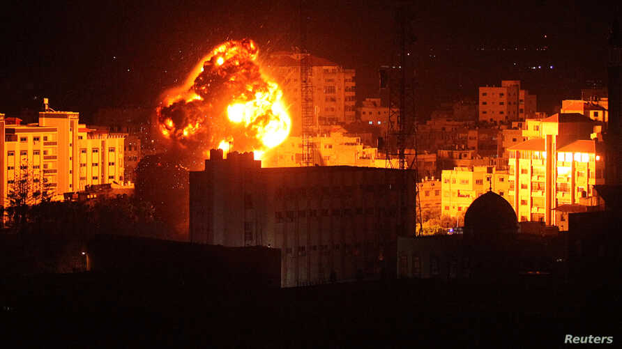 Flame and smoke are seen during an Israeli airstrike in Gaza City, March 25, 2019.