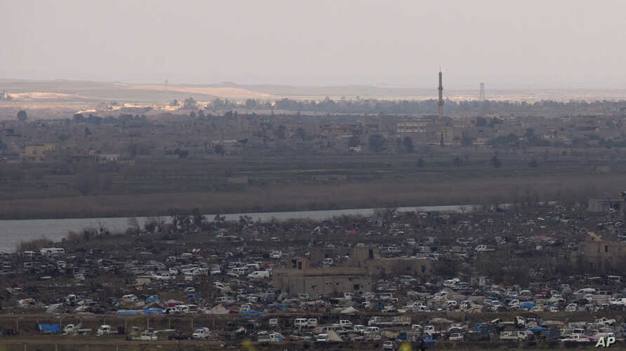 The Islamic State group's last pocket of territory in Baghouz, Syria, as seen from a distance on Sunday, March 17, 2019.