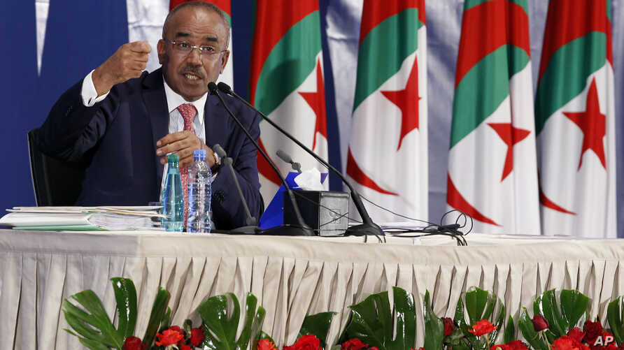Algerian Interior Minister Noureddine Bedoui gestures during a press conference in Algiers, May 5, 2017.