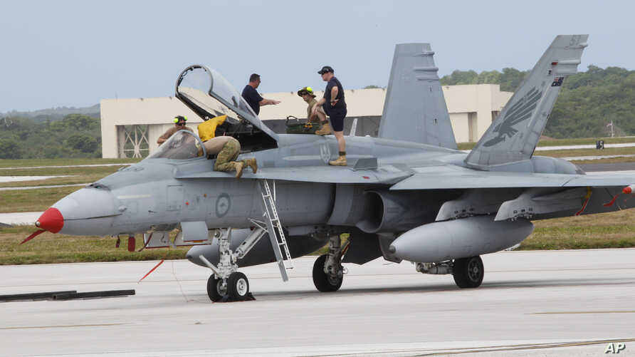 FILE - An Australian fighter jet is readied for a training mission Andersen Air Force Base on the U.S. island of Guam, Feb. 7, 2013. Australia announced Friday that it would recall its fighter jets from Iraq and Syria.
