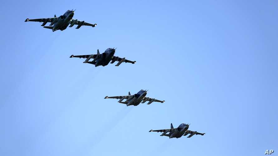 FILE - Russian Su-25 ground attack jets prepare to land after return from Syria at a Russian air base in Primorsko-Akhtarsk, southern Russia, March 16, 2016.