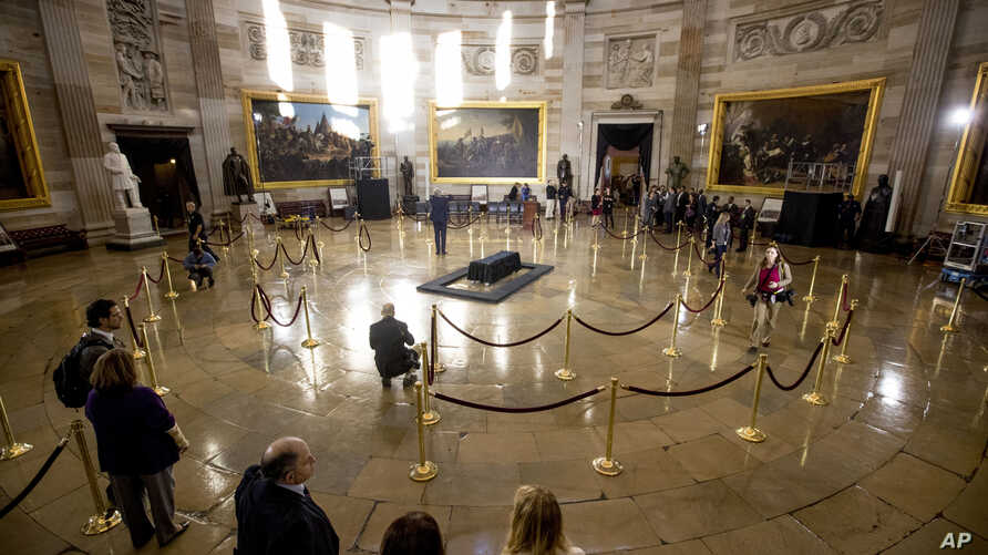 Crews prepare for the late Rev. Billy Graham to be honored Wednesday in the Rotunda of the Capitol Building, Feb. 27, 2018 in Washington.