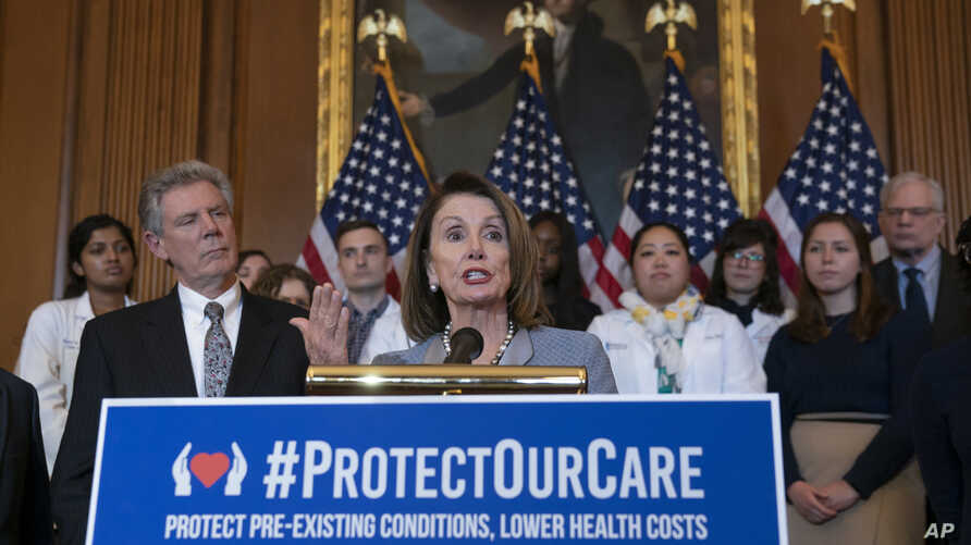 Speaker of the House Nancy Pelosi, D-Calif., joined at left by Energy and Commerce Committee Chair Frank Pallone, D-N.J., speaks at an event to announce legislation to lower health care costs and protect people with pre-existing medical conditions, a