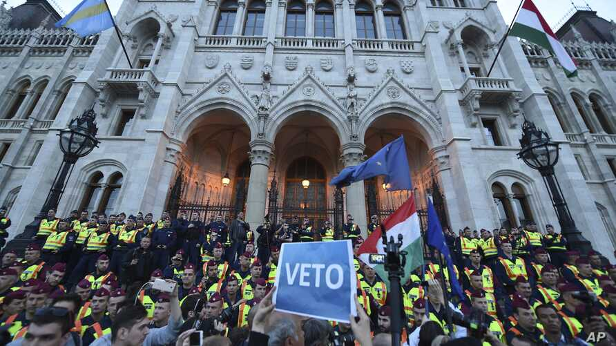 Demonstrators face policemen as they protest against the amendment of the higher education law seen by many as an action aiming at the closure of the Central European University, founded by Hungarian-born American billionaire businessman George Soros...