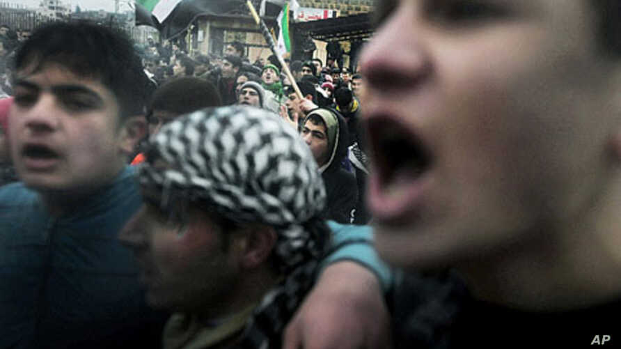 Protesters chant anti-government slogans in the village of Kansafra in the Jabal al-Zawiya region of the northern province of Idlib, December 9, 2011.