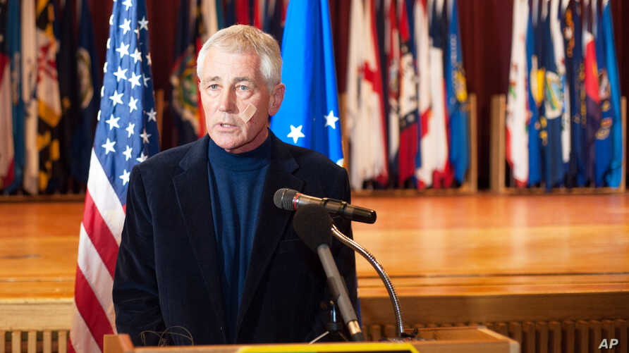 Secretary of Defense Chuck Hagel addresses the media at the Airman's Event during his visit to Minot Air Force Base, N.D., Friday, Nov. 14, 2014.
