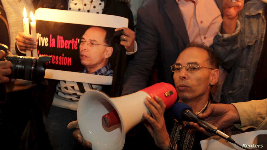 FILE - Maati Monjib, a professor of political history and African studies at the University of Rabat and a writer for national and international news organisations, and his supporters participate in a demonstration near the Moroccan Human Rights Asso