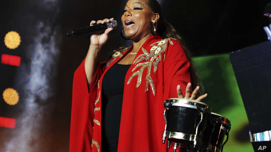 FILE - Queen Latifah performs at the 2018 Essence Festival at the Mercedes-Benz Superdome in New Orleans, Louisiana, July 7, 2018. Latifah will host the 2018 Black Girls Rock awards, which will be taped Aug. 26 at the New Jersey Performing Arts Cente