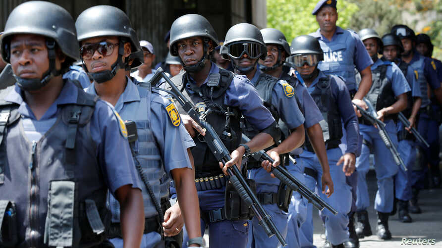 Riot police officers patrol the campus ahead of student protests demanding free education at Johannesburg's University of the Witwatersrand, South Africa, October 11,2016.