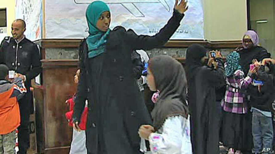 Hafsa Abdelrahman leads the children of the Dar Al-Hijrah weekend school in Falls Church, Virginia, into a mock-up of the Muslim holy city Mecca, October 2011.