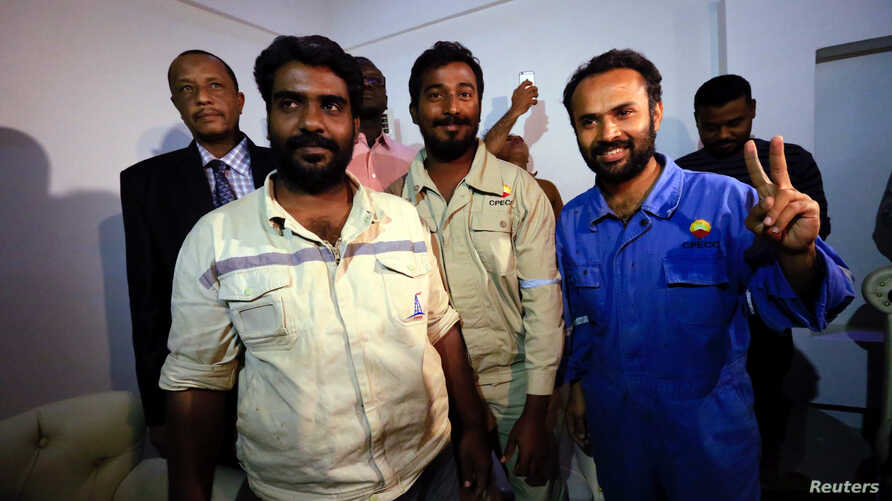 Three foreign oil workers kidnapped by rebels in South Sudan smile as they arrive after being released at Khartoum Airport, Sudan, March 30, 2017.