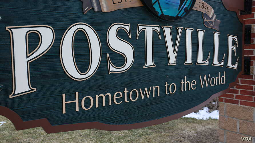 This sign stands at a Postville, Iowa, entrance. (Credit: Deepak Dophal)