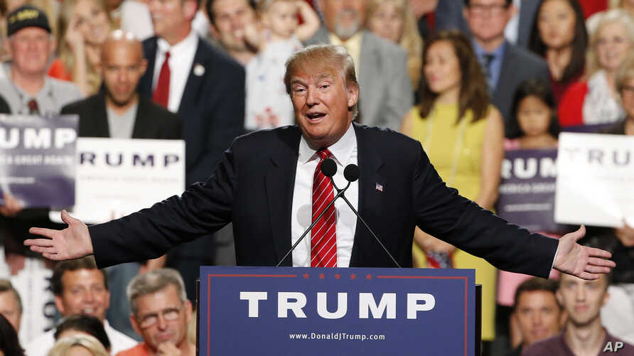 FILE - In this July 11, 2015 photo, then-Republican presidential candidate Donald Trump speaks before a crowd of 3,500, July 11, 2015, in Phoenix. Trump was just a few weeks into his candidacy in 2015 when came to Phoenix for a speech that ended up b