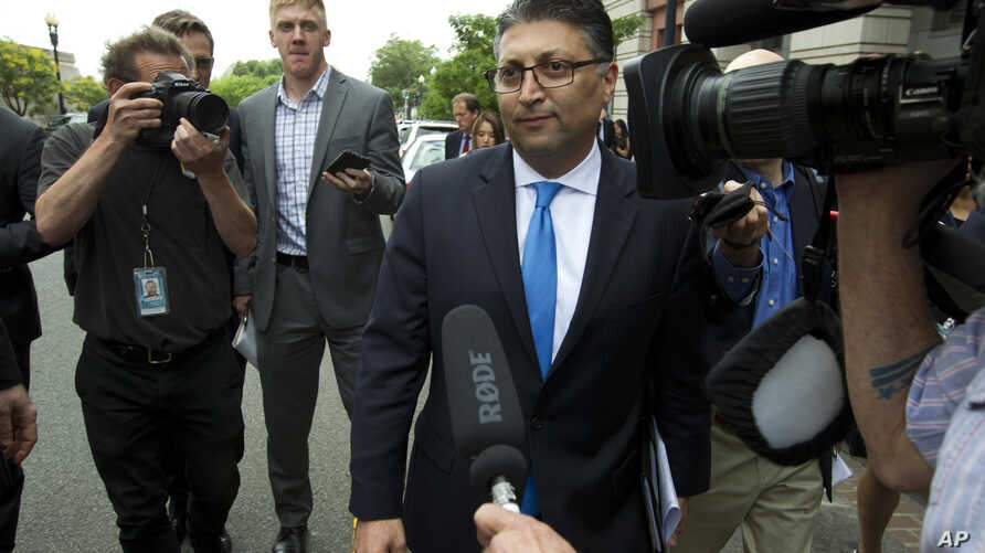 Assistant Attorney General for Antitrust Makan Delrahim leaves the federal courthouse, June 12, 2018, in Washington.