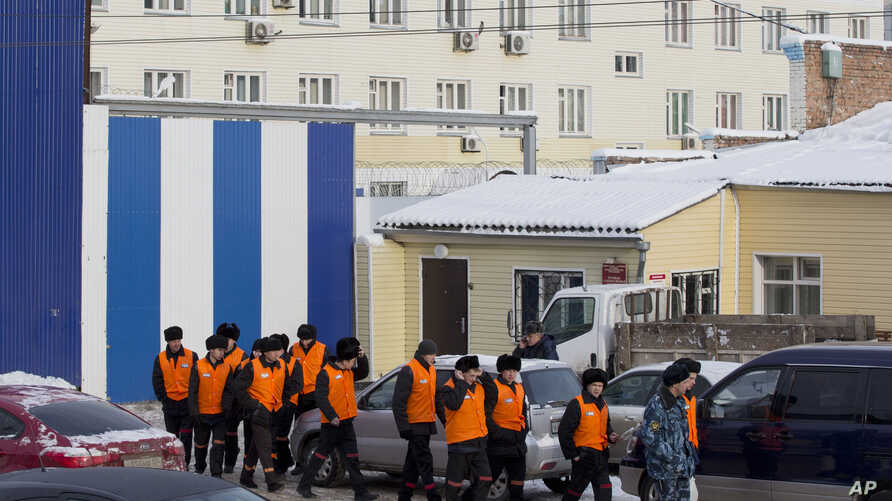 FILE - Female inmates are being escorted to perform work at a penal colony in Krasnoyarsk, Russia, Dec. 20, 2013. Beginning with 2017, the Russian correctional system will introduce forced labor as an alterative to traditional prison sentences.