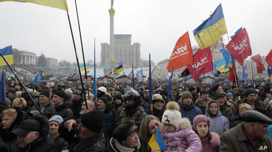 Opposition supporters take part in a rally in Kyiv's Independence Square in Ukraine, Sunday, Feb. 9, 2014.