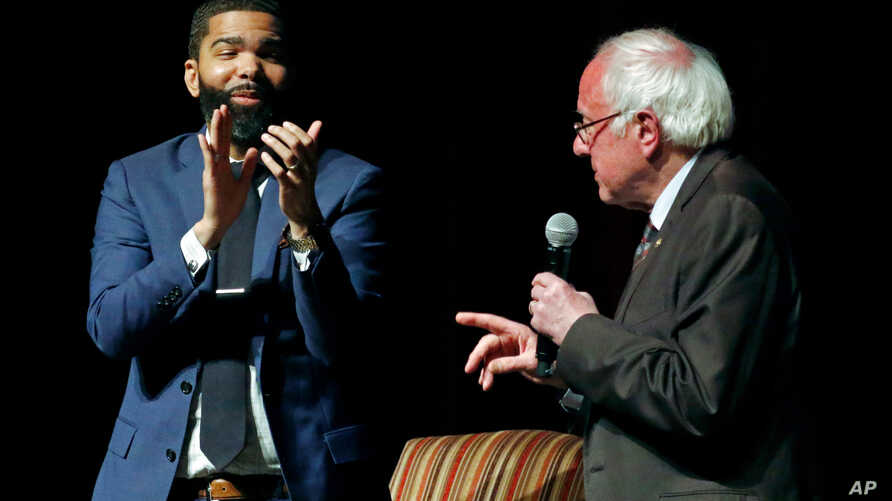 ackson Mayor Chokwe Antar Lumumba, left, applauds as U.S. Sen. Bernie Sanders, I-Vt., answers a question during a town hall meeting examining economic justice 50 years after the assassination of Dr. Martin Luther King Jr., in Jackson, Miss, April 4,