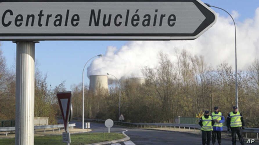 French gendarmes block the access at the nuclear plant in Nogent-sur-Seine after Greenpeace activists managed to sneak into the plant in what they said was a bid to highlight the dangers of atomic energy, December 5, 2011