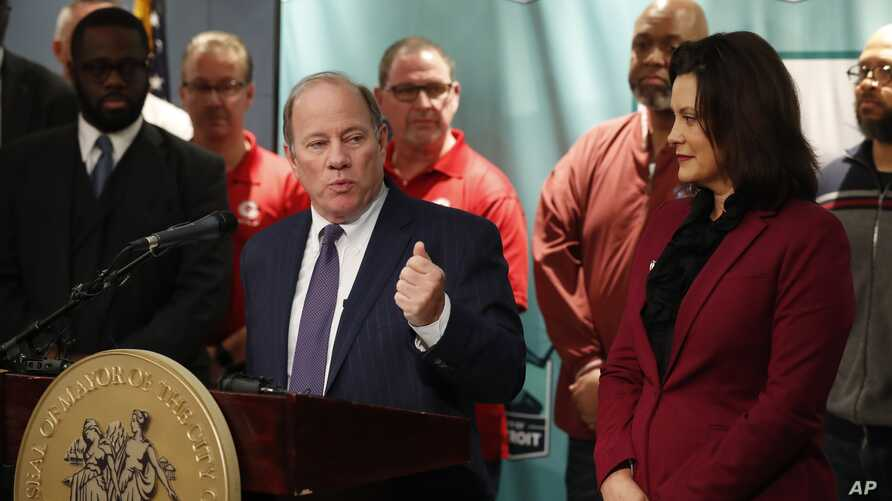 Detroit Mayor Mike Duggan announces plans for Fiat Chrysler to build a new assembly plant include $12 million in tax abatements over a dozen years and 200 acres of land during a news conference in Detroit, Feb. 26, 2019.