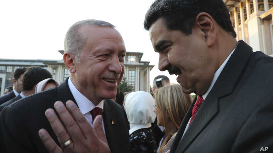 FILE - Turkey's President Recep Tayyip Erdogan (L) talks to Venezuela's President Nicolas Maduro (R) prior to a dinner following a ceremony at the Presidential Palace in Ankara, Turkey, July 9, 2018.