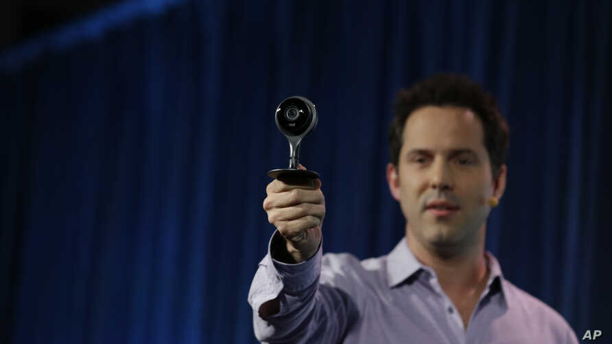 FILE - Maxime Veron, head of Hardware Product Marketing for Nest, holds up a Nest Cam during a press conference in San Francisco, June 17, 2015.