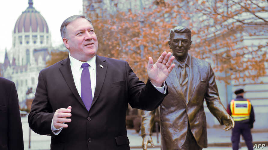 U.S. Secretary of State Mike Pompeo is pictured next to the statue of the former U.S. president Ronald Reagan at the Liberty square (Szabadsag) in Budapest, Hungary, Feb. 11, 2019.