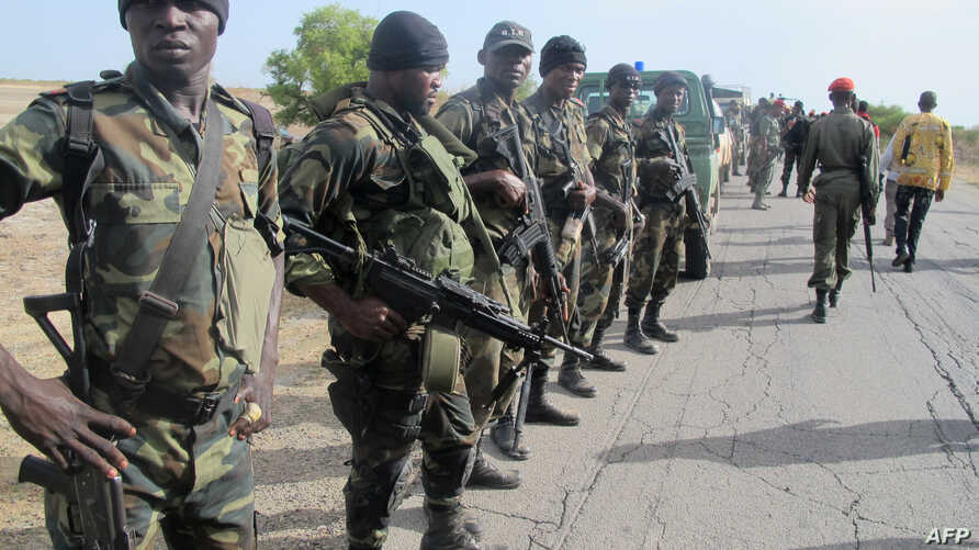 FILE - Cameroon's army soldiers deploy against the Nigerian Islamist group Boko Haram in Dabanga, northern Cameroon, June 17, 2014.
