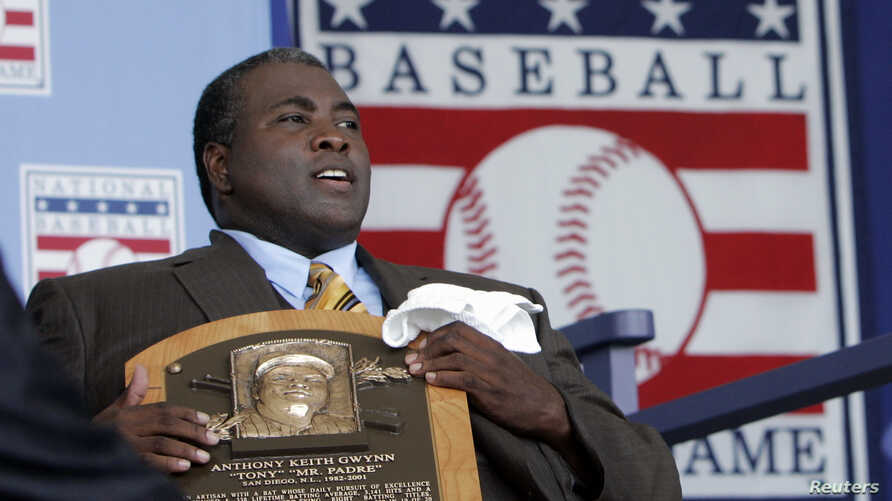 FILE - Former San Diego Padres outfielder Tony Gwynn holds his Hall of Fame plaque following his induction into the National Baseball Hall of Fame in Cooperstown, New York, July 29, 2007.