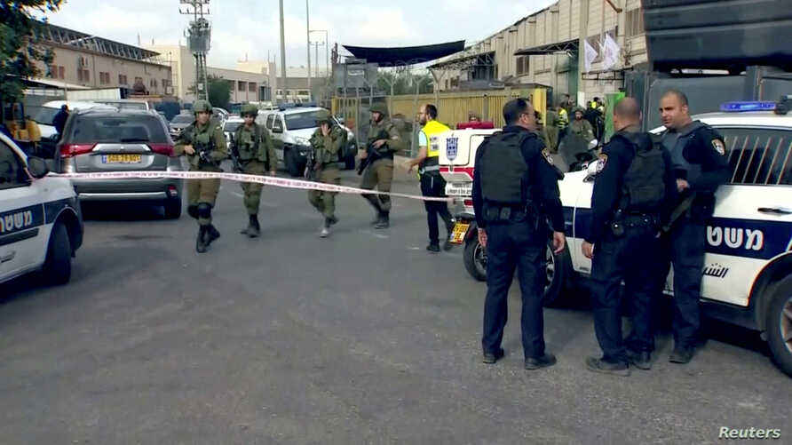 Israeli Forces block the road outside a factory where a Palestinian reportedly opened fire and seriously wounded three Israelis, at Barkan Industrial Zone in the occupied West Bank, Oct. 7, 2018.